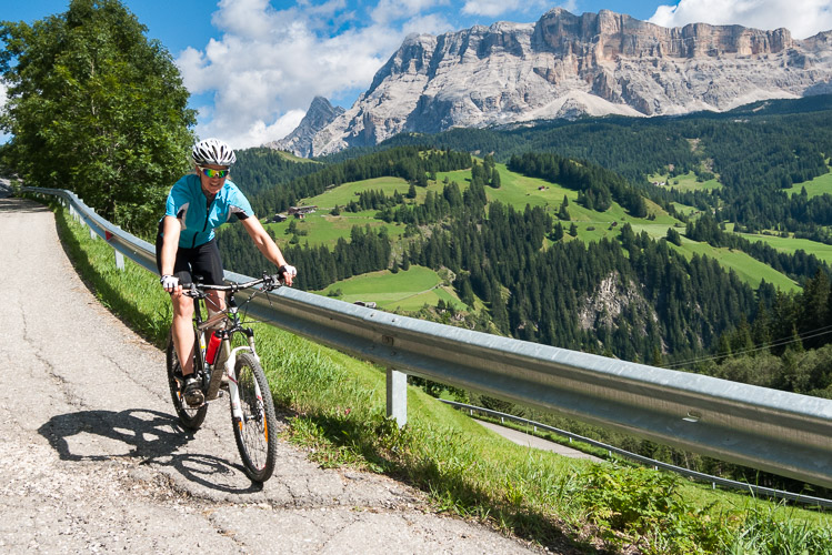 Rhonda Oshanek riding a bike in the Dolomites